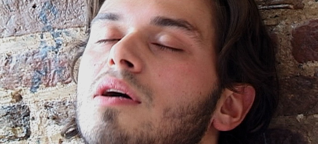 Chris Brinkhof closing his eyes in ecstasy in Headshot, an erotic film directed by Jennifer Lyon Bell for Blue Artichoke Films